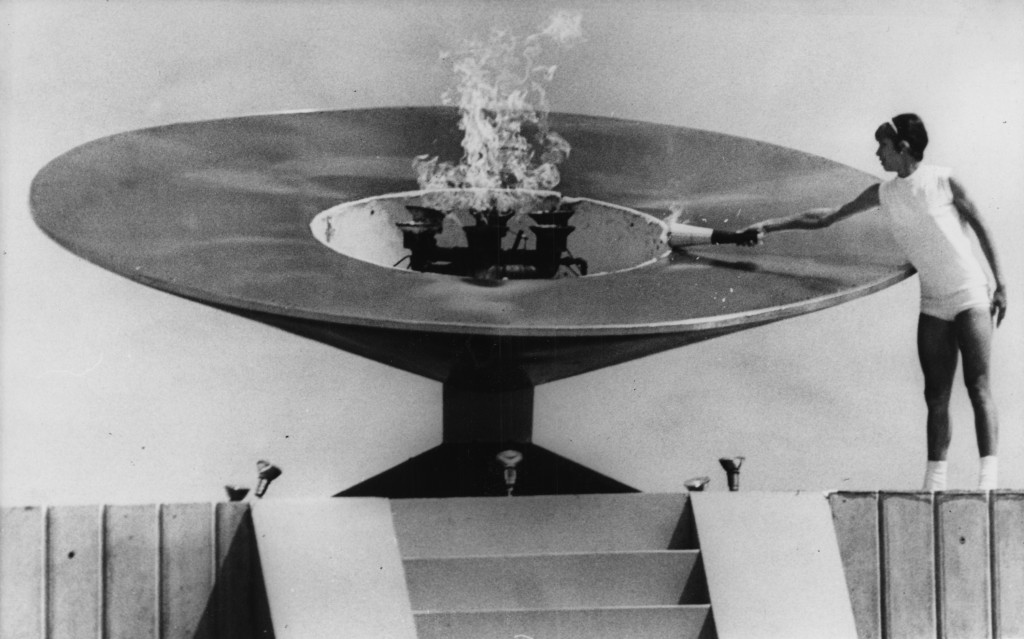 Mexican athlete Norma Enriqueta Basilio last carrier of the Olympic torch is pictured lighting the Olympic Cauldron, during the opening of the 19th Olymic games in Mexico City, Mexico, Saturday afternoon October 12, 1968. (AP Photo/Kurt Strumpf)